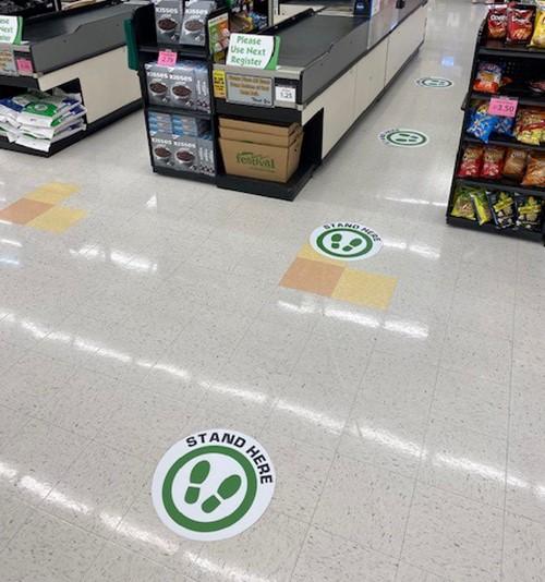 Floor decals showing 6 feet of spacing